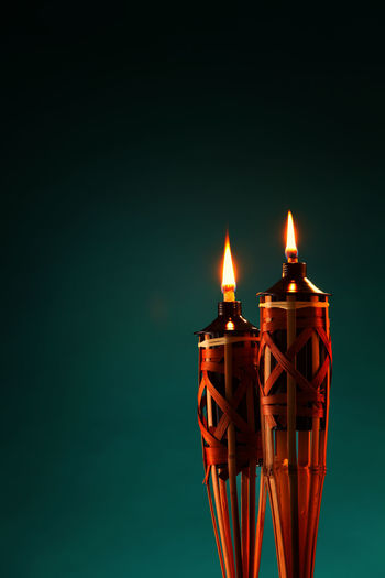 oil lamps on the dark background Celebration Hari Raya Aidilfitri Holiday Icon Light Ornament Ramadan  Weave Ambient Burning Close-up Cutural Festival Flame Greeting Card  Heat - Temperature Illuminated Islamic Event Night No People Oil Lamp Pelita Studio Shot Traditional