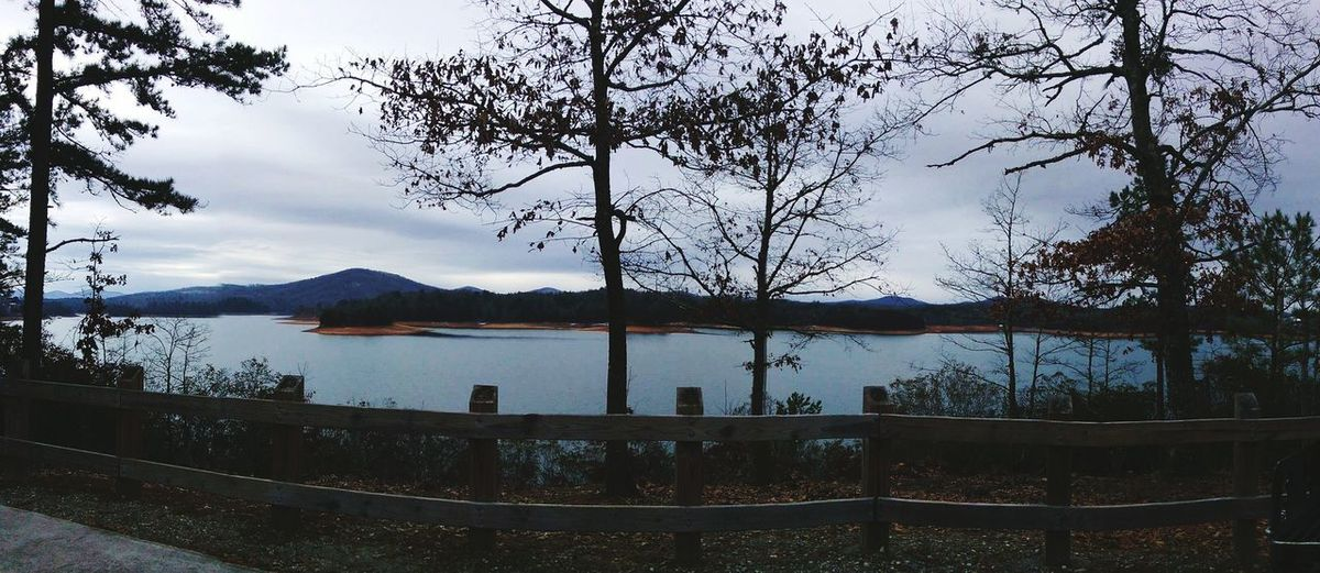 Panaramic View of Lake Nottely between Blairsville GA and Murphy NC. Panoramic Panaroma Tree Woodenfence Bluewater Lakenottely Georgia Recreation Area Water Tree Mountain Lake Sky Cloud - Sky EyeEmNewHere Calm Tranquility Tranquil Scene Shore Idyllic Scenics Fence Tree Area Visual Creativity