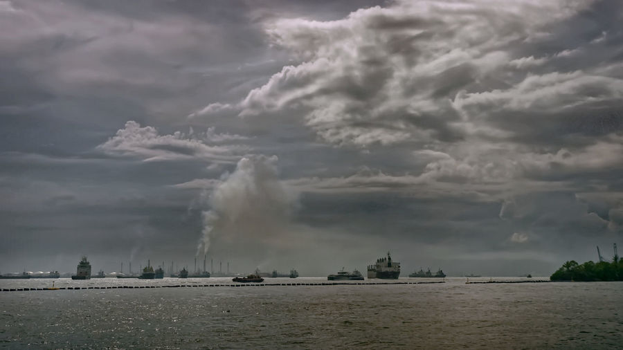 Panoramic view of sea against storm clouds