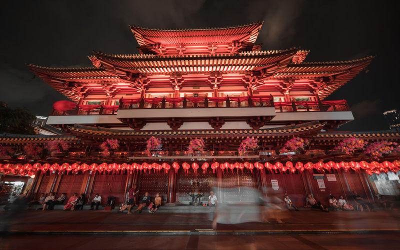 Illuminated temple outside building at night