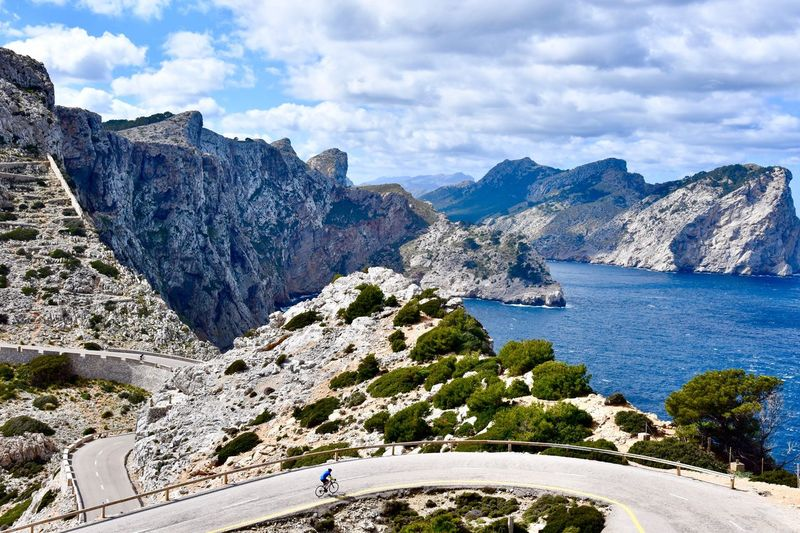 Betterlandscapes Winter In Mallorca Sport Bicycle One Man Only Cycling EyeEmNewHere Mountain Nature Cloud - Sky Sky Beauty In Nature Day Outdoors Scenics Tranquility Mountain Range Sea Landscape Water