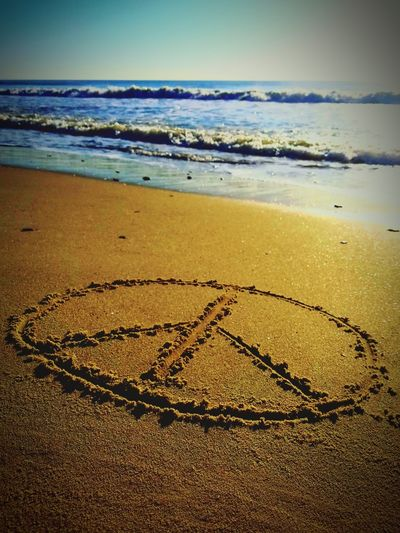Freedom symbol on sand