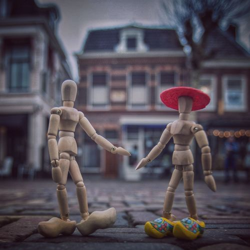 Hi Twiggy, how r u doing in Holland? Clogs Holland Woodyforest Human Representation Male Likeness Focus On Foreground No People Figurine  Statue Sculpture Architecture Outdoors Building Exterior