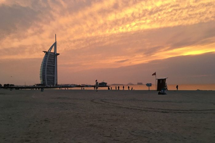 Jumeirah Beach. Dubai, UAE Architecture Beach Beach Life Beauty In Nature Burj Al Arab Cloud - Sky Coastline Day Dubai Horizon Over Water Jumairah Jumeirah Beach Nature Outdoors Real People Sand Scenics Sea Sky Sunset Travel Travel Photography UAE Vacation Water