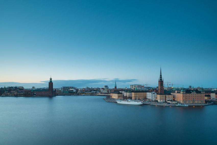 A peaceful evening in Stockholm. Long exposure picture taken from Södermalm, overlooking Riddarholmen, Gamla Stan and Stockholm City. Architecture Building Exterior Built Structure City Cityscape Clear Sky Day Illuminated Nature Nautical Vessel No People Outdoors Place Of Worship Religion River Sky Spirituality Tower Travel Destinations Urban Skyline Water Waterfront