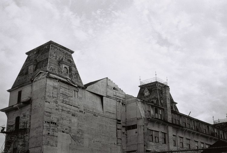 Blast from the past the old abandoned the victorian Wentworth By The Sea hotel 35mm Film Abandoned Places Alone Death Decay Derelict Gothic Macabre Morbid Victorian Abandoned Abandoned Buildings Architecture Blackandwhite Building Exterior Built Structure Cloud - Sky Decaying Building Gothic Style History Hotel Low Angle View Sky Towers Wentworth