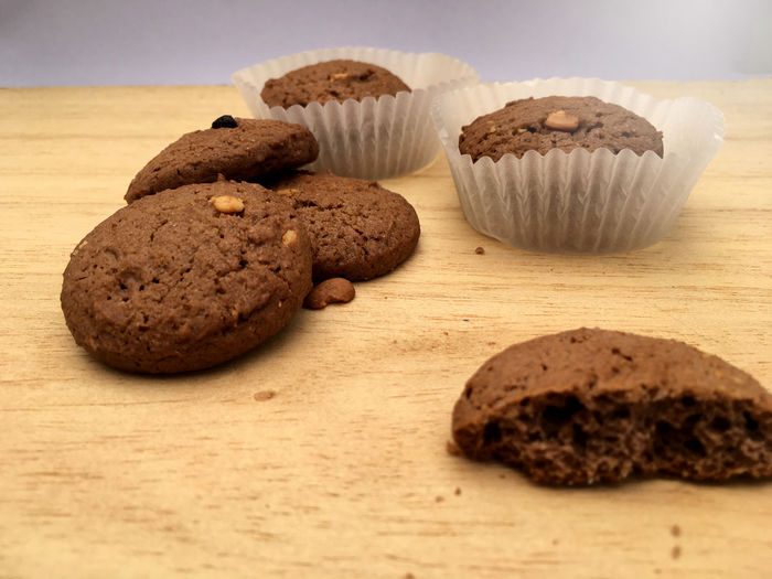 Close-up of muffin and cookies on table