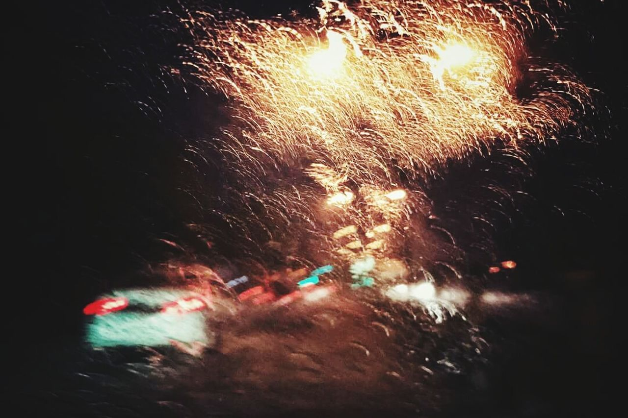 night, glowing, firework display, long exposure, exploding, celebration, arts culture and entertainment, firework - man made object, illuminated, motion, blurred motion, burning, smoke - physical structure, outdoors, no people, firework, close-up