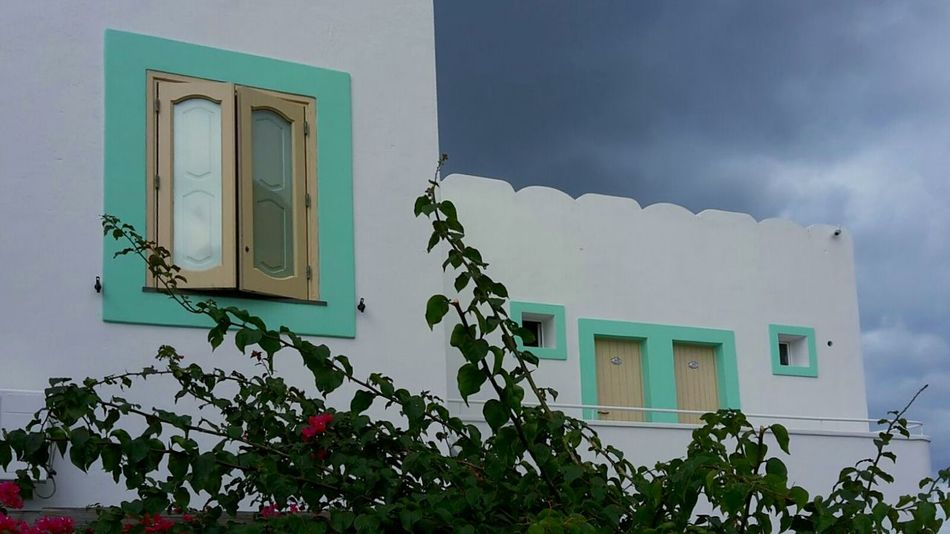 Houses Windows Houses And Windows Window Coloured Windows Dramatic Sky Cloudy Sky Dark Clouds Flowering Bushes White Houses Turquoise Darkness And Light White Album White Wall White Branches And Leaves Ladyphotographerofthemonth Showcase: January Bold Neons, Bright Pastels Pastels Pastel Power