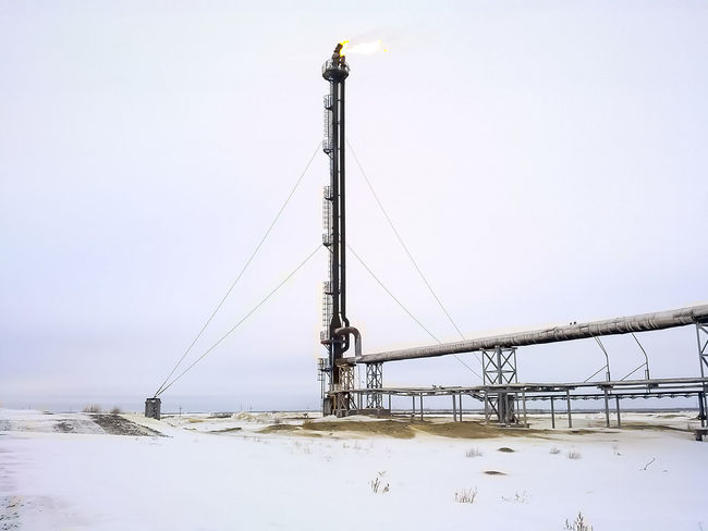 Oil Oil Pump Gas Gasprom Rosneft Refinery Industry Sky Snow Winter Cold Temperature Nature No People Day Clear Sky Outdoors Land Low Angle View Built Structure Environment Copy Space Covering Water Connection Field Transportation Industrial Equipment