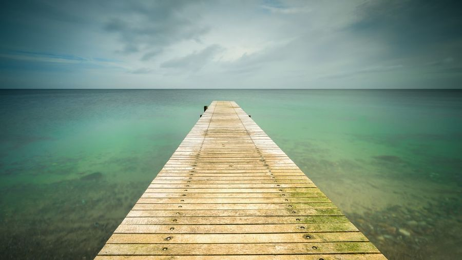 Paradise EyeEm EyeEm Best Shots First Eyeem Photo Landscape_photography Landscape Beach Paradise Ocean Water Scenics - Nature Horizon Sky Beauty In Nature Tranquility Sea Tranquil Scene Direction Nature The Way Forward Horizon Over Water Pier Idyllic Cloud - Sky Wood - Material Outdoors