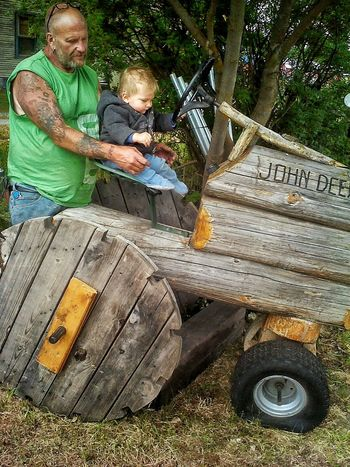 John Deere Tractor Wood Art Father & Son Pretendplay Statue Props Yard Art Backyardphotography Outdoorfun Boy Ride In Style Paint The Town Yellow