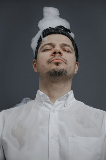 Head In The Clouds Brainstorming Brain Men Business Businessman Technology Portrait Headshot Studio Shot Gray Background Black Background Pixelated Close-up Formal Portrait Pretty Head And Shoulders Caucasian Posing Corporate Business Businesswear Business Casual Smart Casual