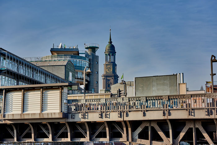 HAMBURG, GERMANY - MARCH 26, 2016: View at elevated railway station, Gruner and Jahr headquarter building and the tower of the famous Michel in Hamburg. Architecture Architecture Blue Sky Chathedral City Cityscape Gruhner & Jahr Hamburg Harbor Headquarters Landmark Marina Miche No People Outdoors Shopping Sky St. Michaelis Tourism Tourist Tourist Attraction  Tranquility Travel Destinations Trip Water