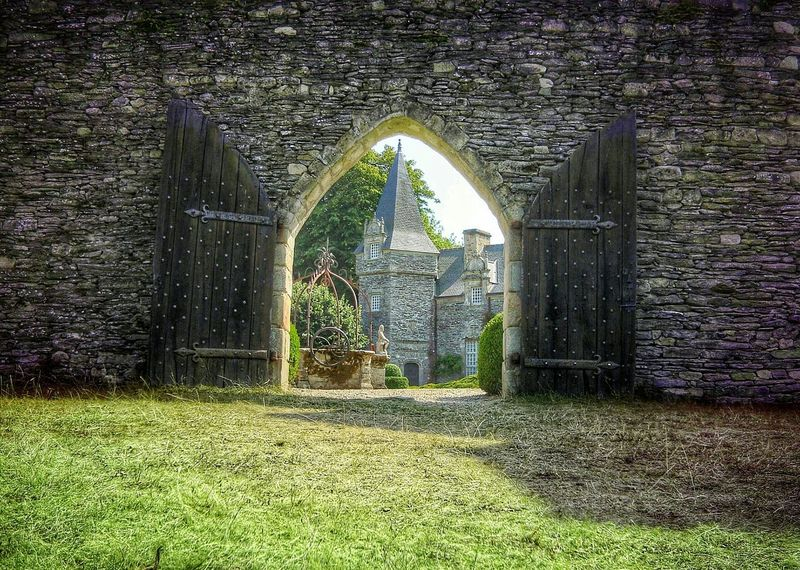 A door to the past Access To The Castle Arch Architecture Battlement Building Exterior Built Structure Castle View  Castle Walls Day Entrance Garden Grass Historic History No People Old Old Doors Outdoors Showcase: February Stone Statue Stone Wall Walled Castles Waterhole