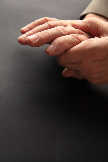 Cropped hands of senior man on table