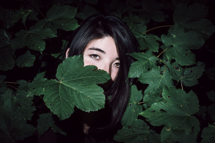 Hiding in the leafs Asian  Asian Girl Beautiful Woman Beauty Black Background Close-up Day Eyes Green Color Growth Headshot Hiding Leaf Mystery Nature One Person One Young Woman Only Outdoors People Plant Portrait Young Adult Young Women Breathing Space The Week On EyeEm Perspectives On Nature Visual Creativity