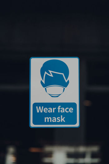 Close up of a wear face mask sign outside a shop in london, uk.