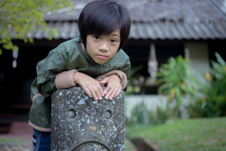 Portrait of cute boy outdoors
