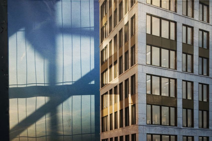 Security Fence Building Sites Built Structure Architecture Building Exterior Shadow Building Day Sunlight City Window No People Office Building Exterior Office Outdoors Pattern Reflection Modern Glass - Material Skyscraper Focus On Shadow