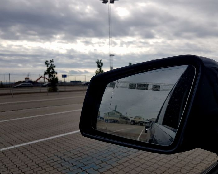Cloud - Sky City Sky Outdoors Day Cityscape No People Mirror Car Rearview Mirror Rearviewmirrorshot Sommergefühle Scandlines Traveling EyeEm Selects EyeEm Best Shots Eyem Gallery Mercedes-Benz Glk350 Geometric Shape Que Waiting In The Car Travel Destinations Journey Time To Reflect