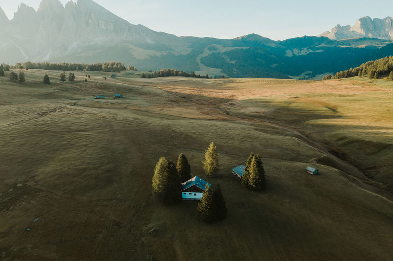 A lone hut sits in a beautiful field at Alpe Di Suisi in the Italian Dolomitesa Week On Eyeem Indoors  Aerial View Aerial Photography Dji Mavic Pro 2 Alpe Di Siusi Mountains Dolomites, Italy Dolomiti House Travel Destinations Water Landscape Seiser Alm Mavic Pro Tranquil Scene Beauty In Nature Mountain Range Mountain Scenics - Nature High Angle View Sky Outdoors Tranquility