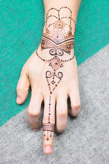 Close-up of woman hand with tattoo