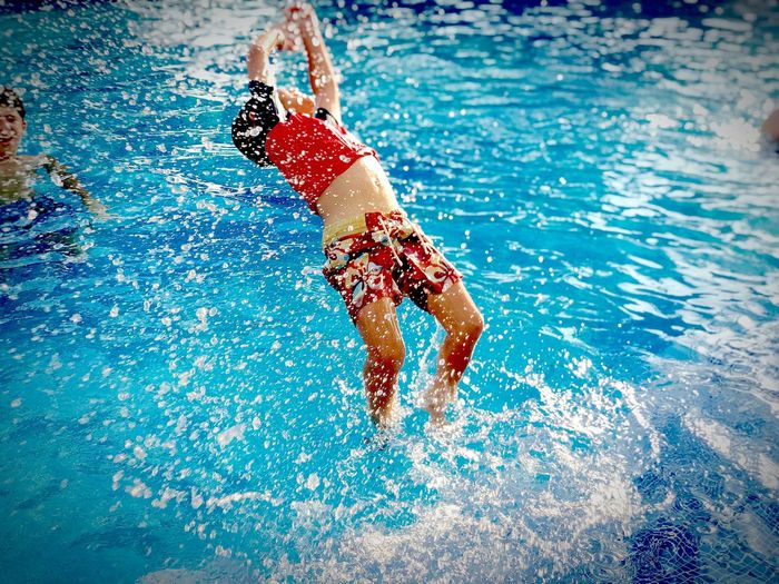 Fun EyeEm Best Shots Family Vacation Time Sea And Sky Love Fsk Rasask Water Nature Pool Swimming Pool Lifestyles High Angle View Exploring Fun Real People Blue Splashing One Person Swimming Leisure Activity Outdoors Motion Sport Men Wet Day