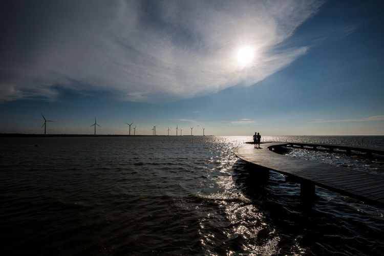 Couple Gaomei Wetland Love Taichung Taiwan Wind Turbine Beauty In Nature Horizon Over Water Nature Outdoors Scenics - Nature Sea Silhouette Sky Sun Sunset Turbine Water Wind Power Wind Turbine