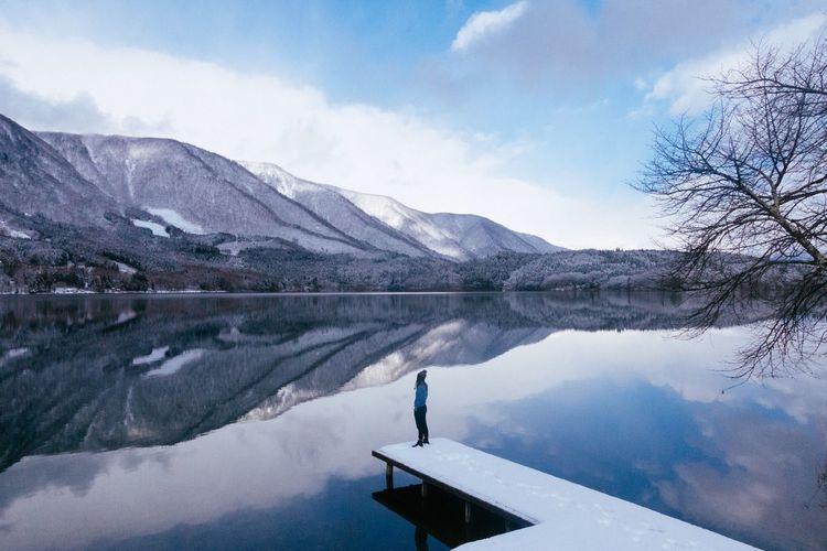 Mountain Lake Snow Beauty In Nature Reflection Nature Sky Scenics Tranquil Scene Outdoors Mountain Range Idyllic Water Tranquility Waterfront Day One Person Winter Snowcapped Mountain Cold Temperature