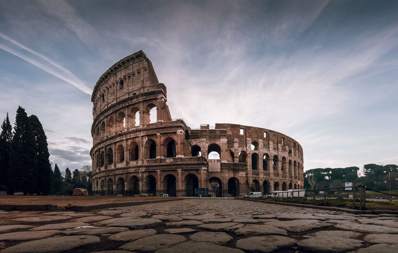 Colosseum in rome at sunrise panorama Architecture Sky History The Past Travel Destinations Built Structure Travel Cloud - Sky Building Exterior Arch Tourism Ancient Nature Old Ruin Ancient Civilization City Amphitheater Old No People Outdoors Archaeology Ruined Colosseum Sunrise Blue Sky