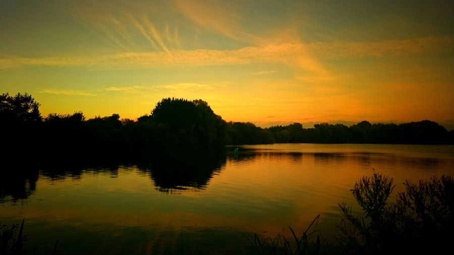 On my way back from my sisters down in wiltshire uk i just had to stop at one of the lakes in Ashton Keynes and get a shot of the sunset over the water Taking Photos Fine Art EyeEm Gallery Nature Photography EyeEm Best Shots Beauty In Nature Shadows Naturelovers Shadows & Lights Nature Trees Ruralscenes Evening Sky Eveninglight Sunset Sunsets Sunrise_sunsets_aroundworld Water Reflections Lakeside Lakes