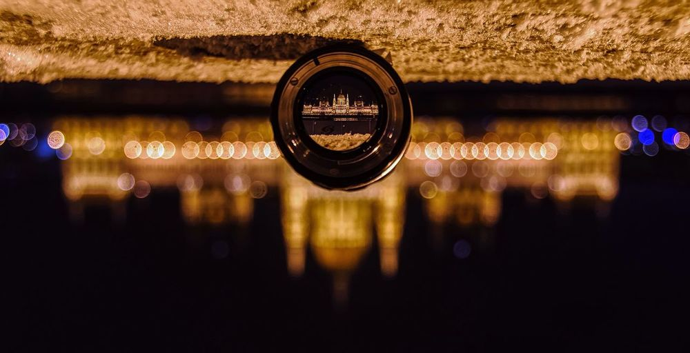 Upside down view of hungarian parliament through lens