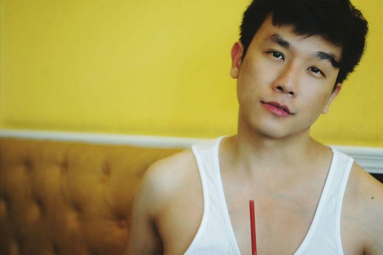 Portrait of man wearing tank top indoors