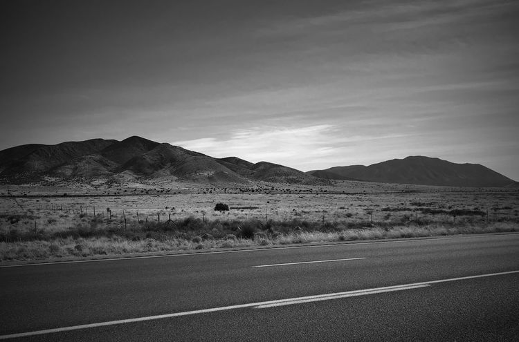 """""""From Here To There"""" Stretch of Mountains that include the 9,000 ft. Carrizozo Mountain off Highway 54 near Carrizozo, NM New Mexico Photography New Mexico Highway Blackandwhite Photography Black & White Black And White Blackandwhite Road Mountain Transportation Landscape Sky Nature Asphalt No People Mountain Range Outdoors Desert"""