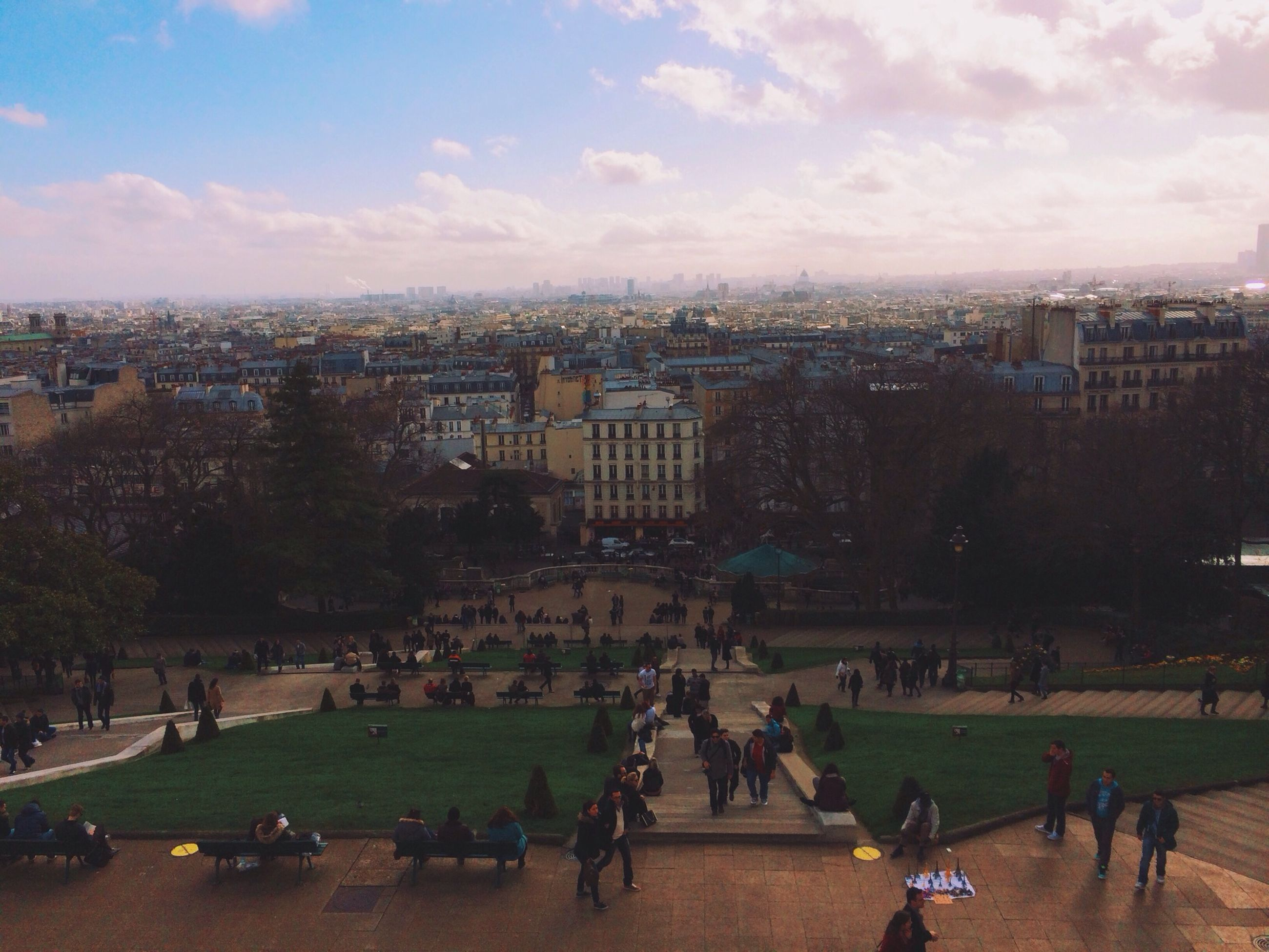 large group of people, architecture, building exterior, built structure, grass, sky, men, lifestyles, city, person, leisure activity, tree, high angle view, cloud - sky, park - man made space, city life, lawn, tourist, mixed age range