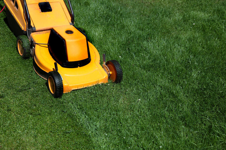 High angle view of lawn mower on grassy field