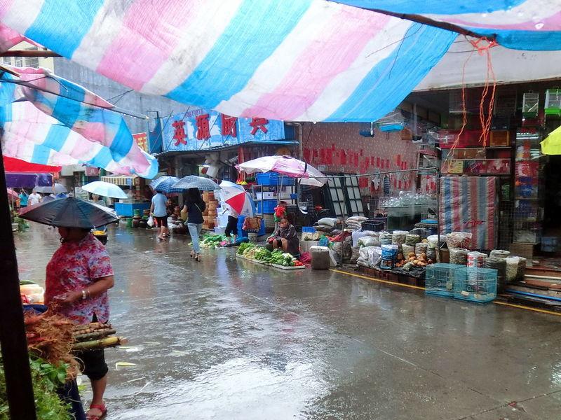 Rainy day stroll Market Market Stall Outdoors Rainy Day Small Business Stalls Stalls At Sunday Market The Mix Up Wet Market