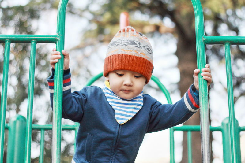 Front view of cute boy at playground