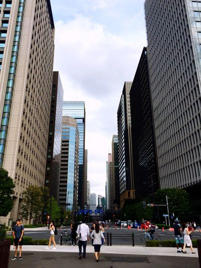 Coming out Skyscraper Architecture Built Structure Modern City Building Exterior Large Group Of People Urban Skyline Cityscape Downtown District City Life