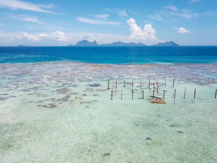Blue azure turquoise lagoon with corals. pulau bum bum island in sampoerna, sabah, malaysia.
