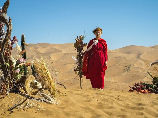 SandGoddess Desert Sand Dune Clear Sky Sand Arid Climate One Person Full Length Standing Nature Landscape Outdoors Day Blue Red Sky Portrait Shadow Adult Real People Young Adult Flowers Lost In The Landscape
