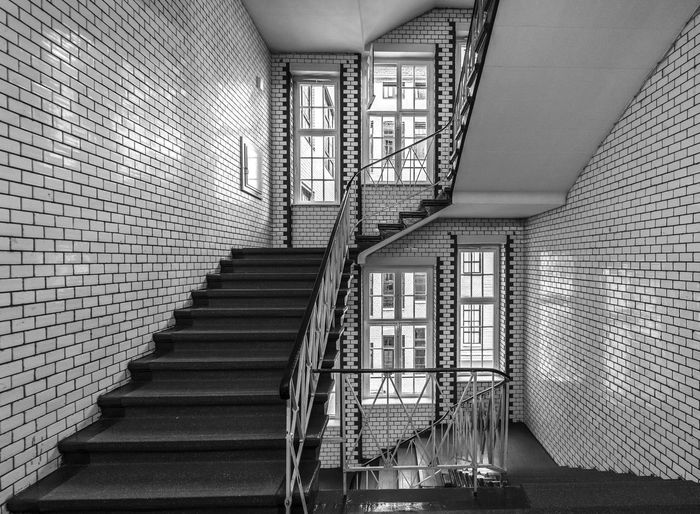 Black And White Urban Best Of Stairways Reflection Old Staircase Steps And Staircases Architecture Railing Indoors  No People Built Structure Building Absence Wall - Building Feature Wall Low Angle View Empty Window Metal Pattern Illuminated Lighting Equipment Ceiling Day Brick