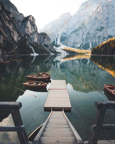 Pier over lake against mountains