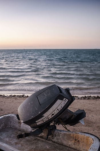 Abandoned Beach Boat Day Detail Horizon Over Water Motor Nature No People Ocean Outdoors Sea Sky Sunset Water Waves
