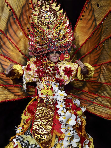 Spectacular Costumes worn by Participants in Jember Fashion Carnaval. One of the top local festivities in Indonesia and 4th biggest carnaval in the world. Black Background Carnival Celebration Fashion Art Attractive Carnaval Color Image Colorful Costume Cultures Eye Em Best Shots Facial Expression Festival Festive Front View Glamour Jember Fashion Carnival Light And Shadow Parade Performing Arts Event Traditional Costume