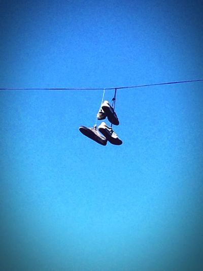 Outdoors Low Angle View Clear Sky Blue Copy Space Day Shoes No People Transportation Mid-air Flying Nature Sky Ski Lift