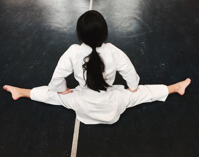 Rear View Of Girl Doing Splits In Class