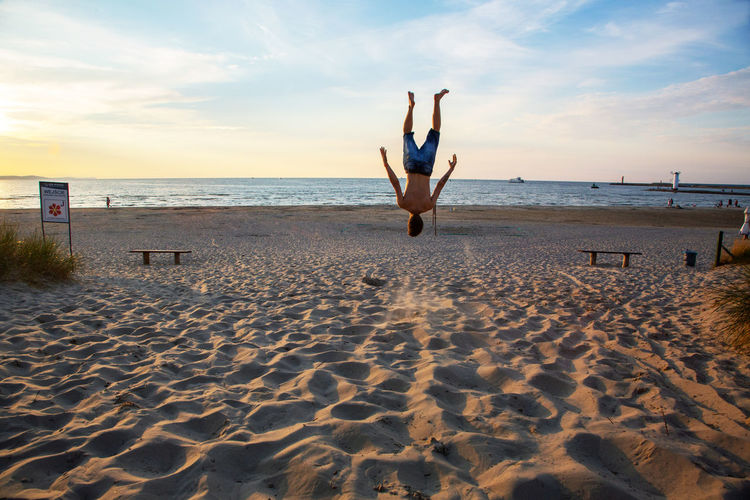 Baltic Sea Jump Arms Raised Beach Beauty In Nature Cloud - Sky Full Length Handstand  Holiday Horizon Horizon Over Water Human Arm Jumping Land Leisure Activity Lifestyles Nature One Person Outdoors Sand Scenics - Nature Sea Sky Vacations Water