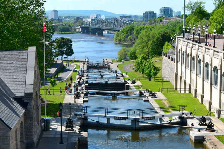 Architecture Bridge Building Exterior Built Structure Bytown Museum City City Life Day Diminishing Perspective Lake Locks Lockstation Mode Of Transport Nautical Vessel Ontario Ottawa River  Province Border Quebec Rideau Canal River Transportation Travel Destinations Tree Water Waterfront